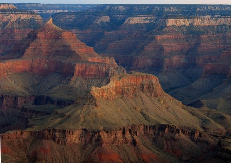 synonymous: The Grand Canyon has so many colors! This shot provides only a hint of the vastness that is synonymous with this world famous landmark.