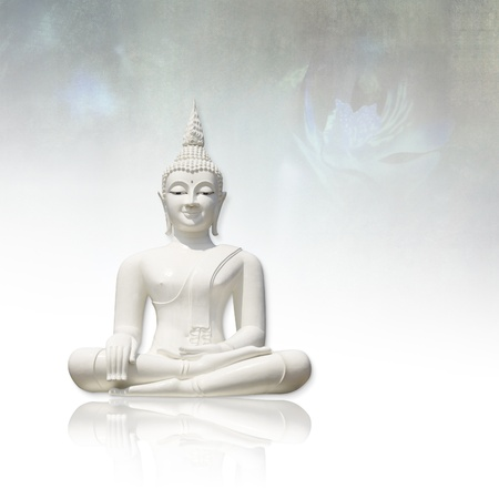 White buddha     isolated against light grunge background photo