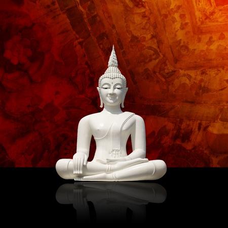 Isolated white buddha against colorful background   photo