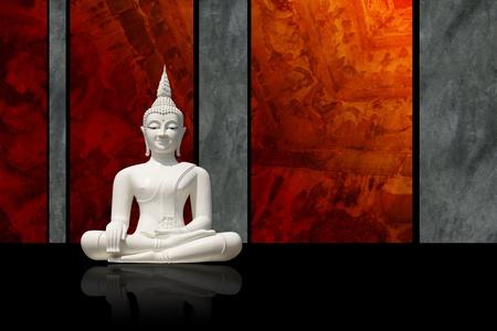 godhead: White Buddha statue, isolated against dark colorful background  Stock Photo