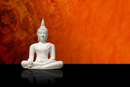 enlighten: White buddha statue, isolated against colorful grunge background