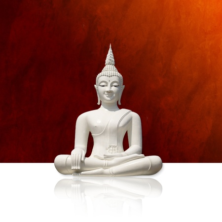 White buddha, isolated against orange-red background (incl. clipping path) photo
