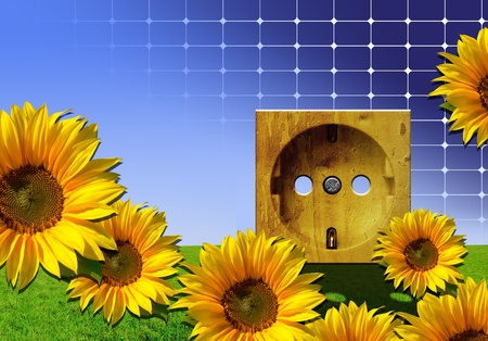 Wooden power outlet against blue sky with photovoltaic solar cell texture and sunflower and grass background - green energy concept photo