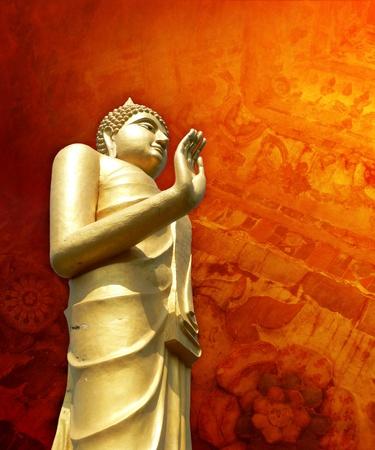 budha: Golden buddha statue in Thailand with grunge orange red background Stock Photo