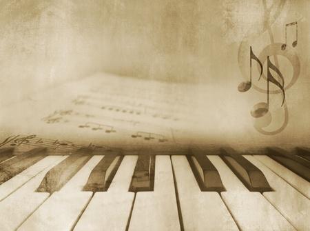 piano: Grunge muzikale achtergrond - pianotoetsen en bladmuziek - vintage design in sepia toon Stockfoto
