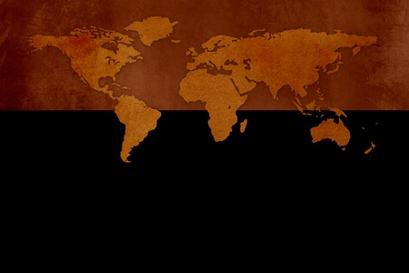 Old grunge world map against black background Stock Photo