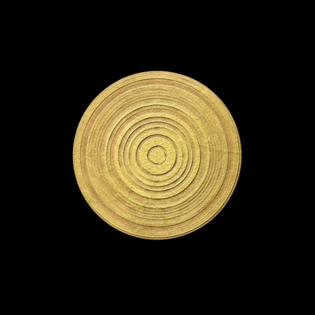 Gold plate against black background photo