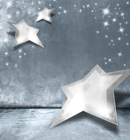 Silver stars against blue gray background - abstract Christmas design with sparkle lights photo