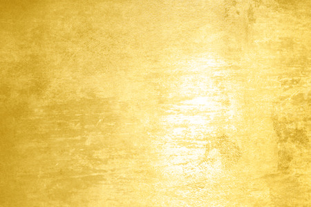 Polished gold texture - abstract yellow background photo