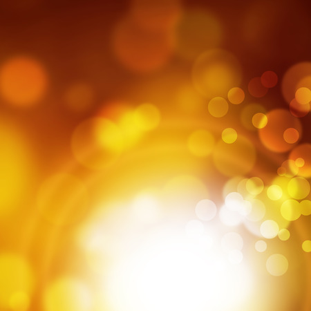 gold brown: Abstract blurred bokeh background in yellow gold brown colors with white light effect Stock Photo