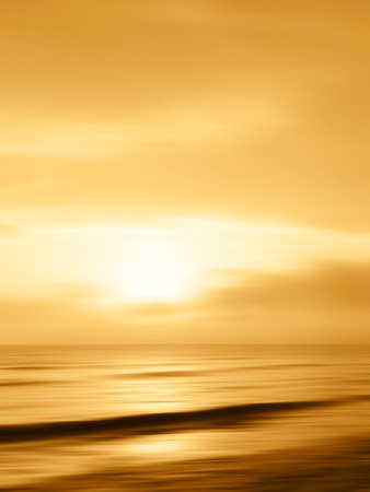 soothing: Blurred golden sunset background over the sea Stock Photo
