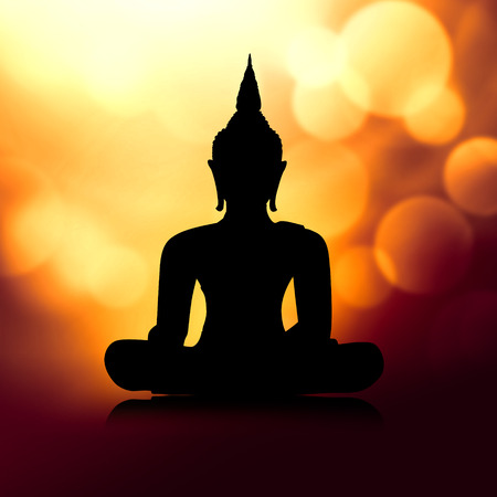 Buddha silhouette in lotus position - meditation concept Stock Photo