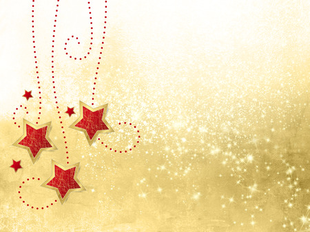 december: Christmas decoration with hanging stars against gold sparkle background Stock Photo