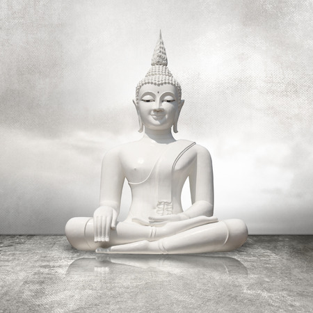 budha: White buddha sitting in lotus position against light gray sky background