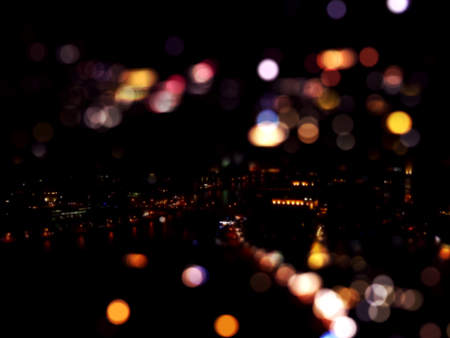 City lights at night with bokeh effect in Dubai Marina in blurred style