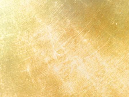 Fondo de metal dorado con efectos de brillo.