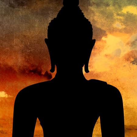 Buddha silhouette against sunset sky background
