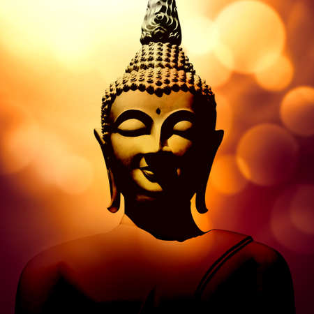 Buddha head against shiny bokeh lights