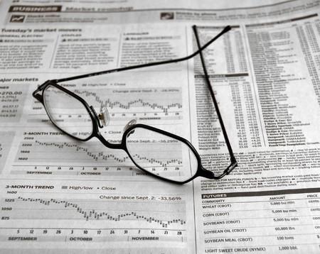 dow: Black eyeglasses on business newspaper