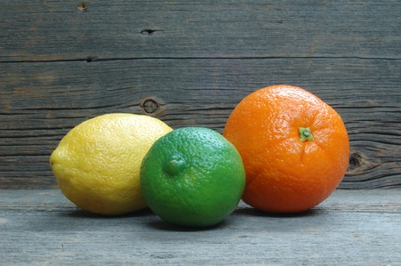 barnwood: Lemon, lime and orange on distressed old barnwood