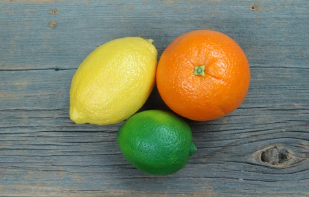 barnwood: Lemon, orange and lime on distressed old barnwood plank