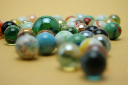 Colorful glass marbles amid one large marble Stock Photo - 4551617