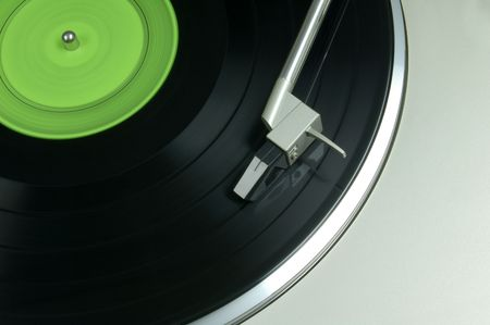 phonograph: Vinyl record being played on phonograph