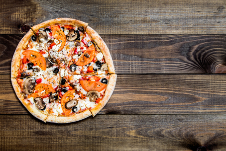 Delicious italian pizza on wooden table, close-up. Archivio Fotografico