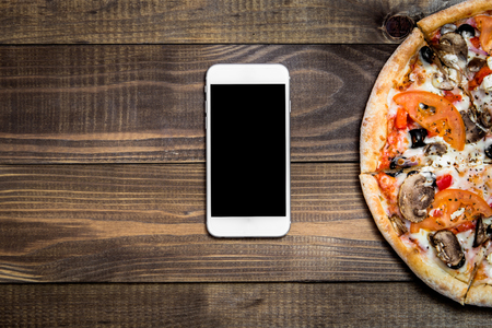 Pizza, Italian food delivery, call or order online on mobile, cellular, smart phone. Archivio Fotografico
