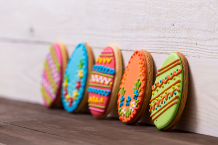 Delicious Easter cookies on wooden background. Easter concept.