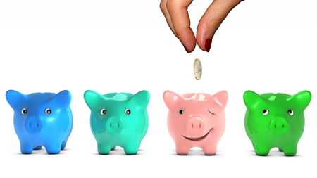 Woman s hand choosing a piggy bank and giving it a piece of money  photo