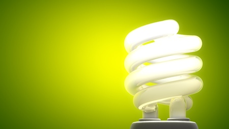 eficiencia energética: Lámpara fluorescente compacta Fondo verde, la metáfora ecológica Foto de archivo