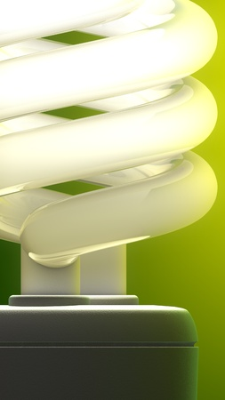 Compact fluorescent lamp close-up  Green background, ecological metaphor  photo