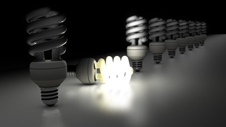 Compact fluorescent lamps in a row  One is lamp is enlightening  Idea Concept photo