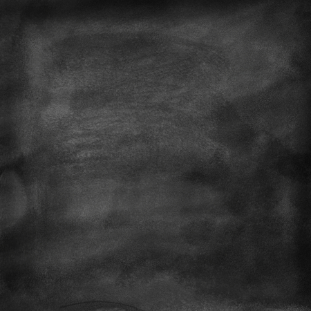 A cleaned blackboard. Wet sponge and chalk traces are visible. Background texture.