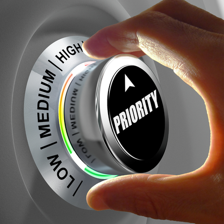 choosing selecting: Hand rotating a button and selecting the level of priority. This concept illustration is a metaphor for choosing the level of priority (task). Three levels are available: low, medium and high.