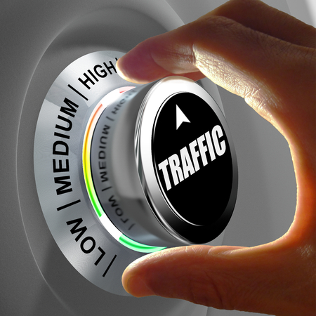 choosing selecting: Hand rotating a button and selecting the level of traffic. This concept illustration is a metaphor for choosing the level of traffic (web site, car...) . Three levels are available: low, medium and high. Stock Photo