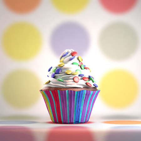 cream colored: Delicious cupcake with smarties on a whipped cream. Colored disks background. Stock Photo