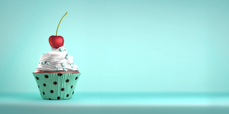 Delicious cupcake topped with a cherry with whipped cream and sweeties. The cherry on the cake metaphor. Copy space.