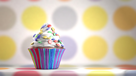 smarties: Delicious cupcake with smarties on a whipped cream. Colored disks background. Copy space Stock Photo