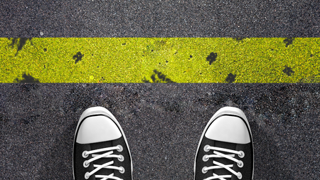 a righteous person: Cross the yellow line Concept illustration showing shoes in front of a yellow line. Stock Photo