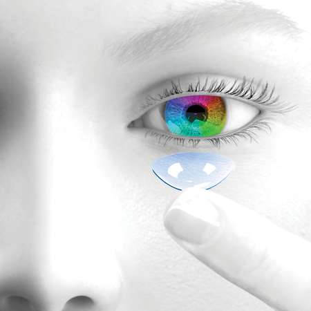 A woman puts contact lenses. 3d render. Face is greyscale. The iris and the lens are colored. 写真素材