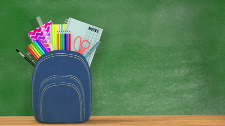 satchel:  A blue Satchel full of school supplies in front of a green blackboard into a classroom. Stock Photo