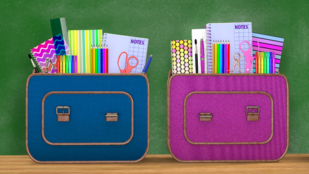 Back to school. Two vintage backpacks full of school supplies for boys and girls into a classroom.