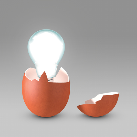Conceptual picture of a nascent idea. The light bulb is hatching from the eggshell like a newborn idea. Copy space available.