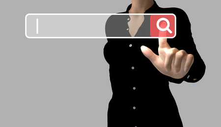 A business woman makes an online search by touching a search button. The cursor indicates the text to enter. Stock Photo
