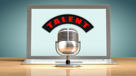 lyrical: Laptop in front of a vintage microphone. Metaphor on talent recruitment through the internet.