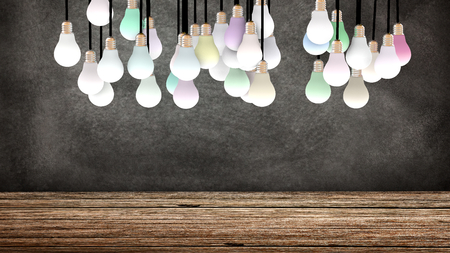 colored lights: Several suspended light bulbs in front of a blackboard. Colored lights are powered on. Copy space available. 3D Rendering Stock Photo