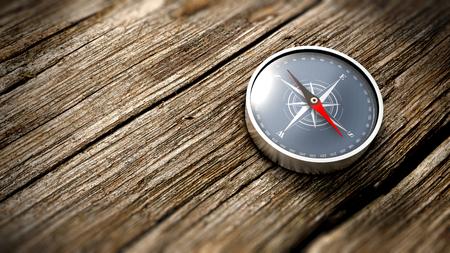 puntos cardinales: Brújula que muestra el norte en una mesa de madera. Cierre de vista. concepto objetivo. Representación 3D