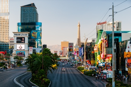 View of Las Vegas Strip  Street filled with many casinos imitating famous building from all around the world such as Aiffel Tower or New York city landmarks